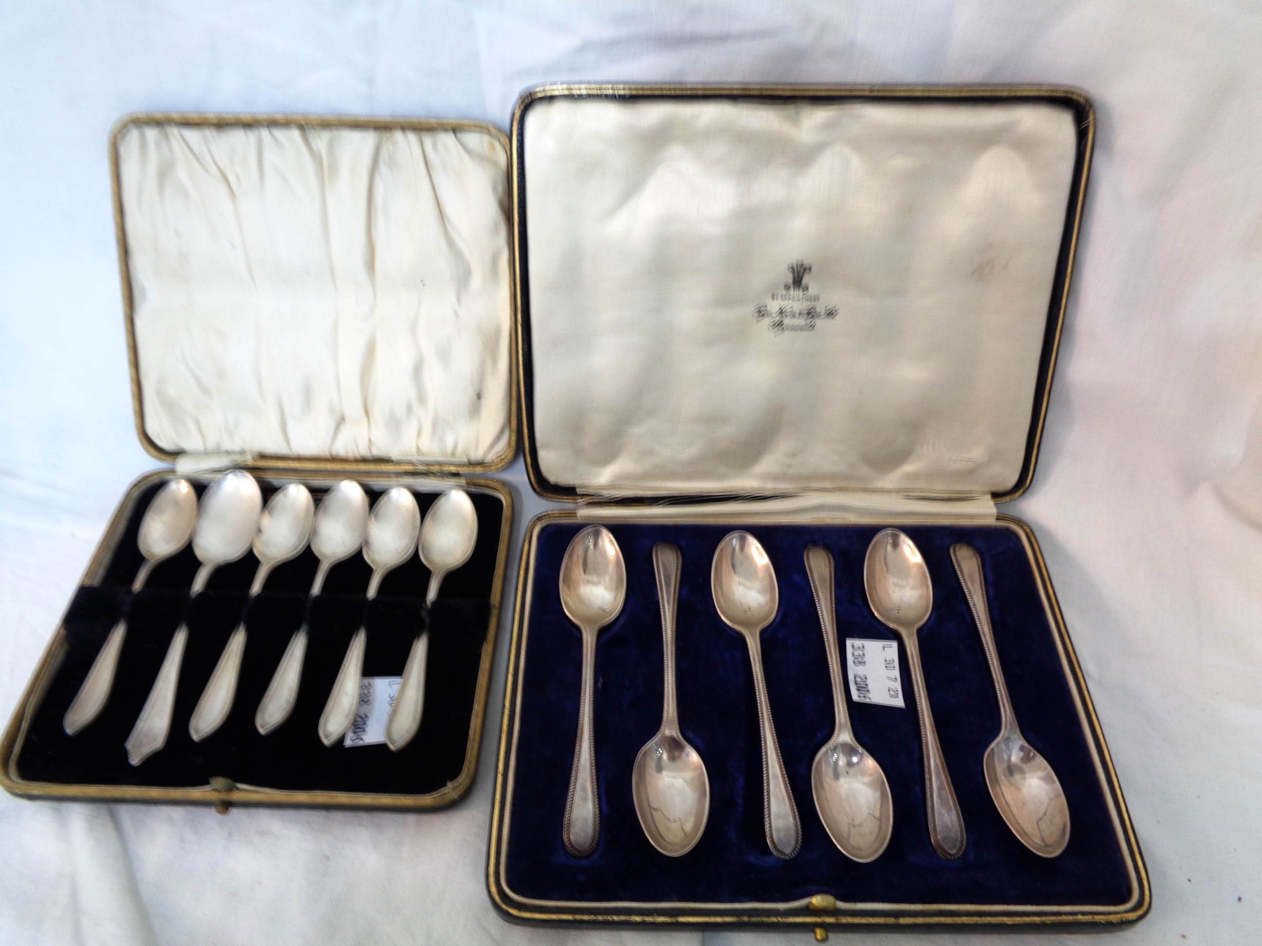 A cased set of six silver teaspoons - sold with a cased set of six silver coffee spoons