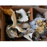 A box containing a large quantity of resin and ceramic figurines
