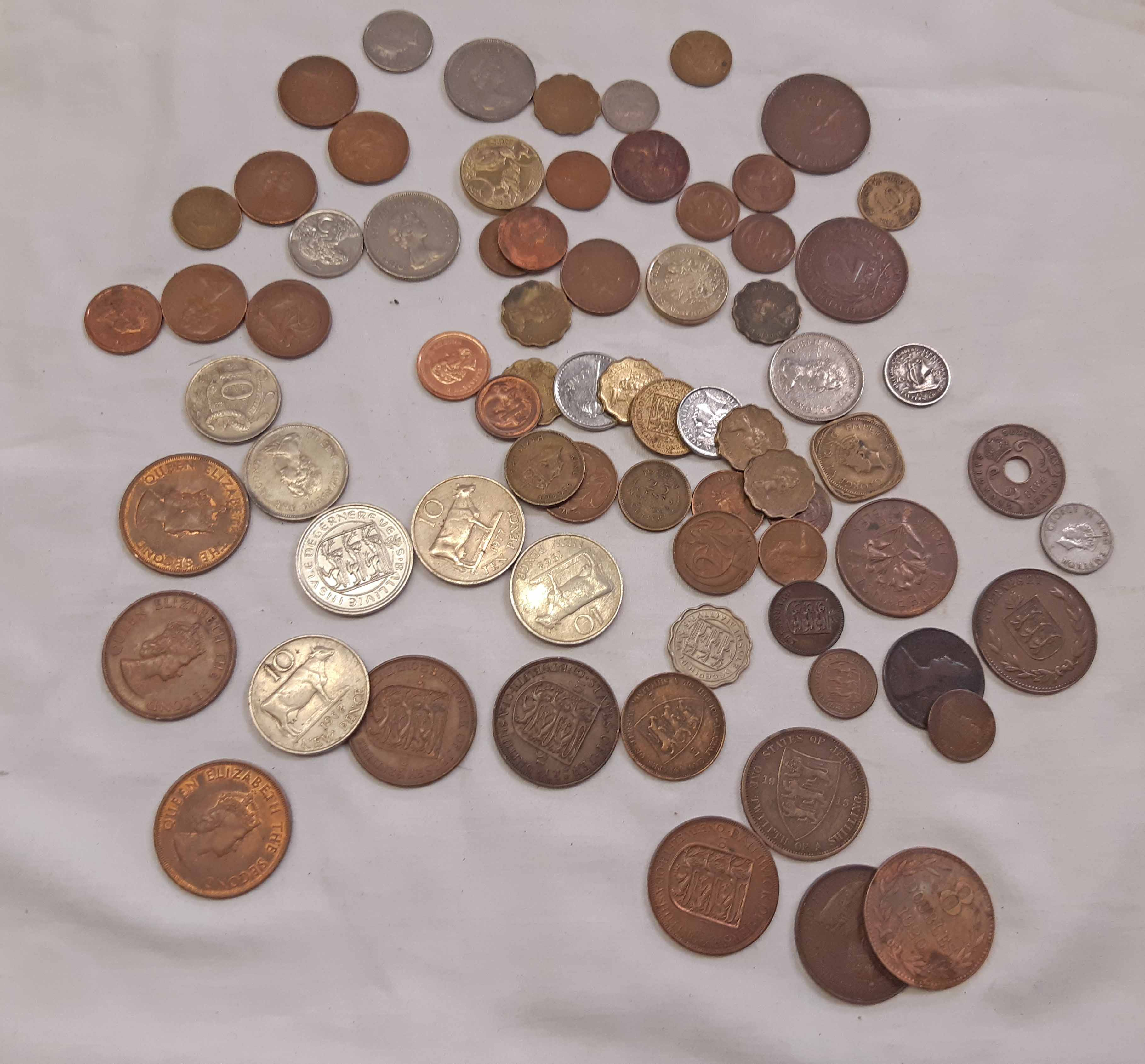 A sweet tin containing twenty Channel Island coins post 1929 and a quantity of coins from the