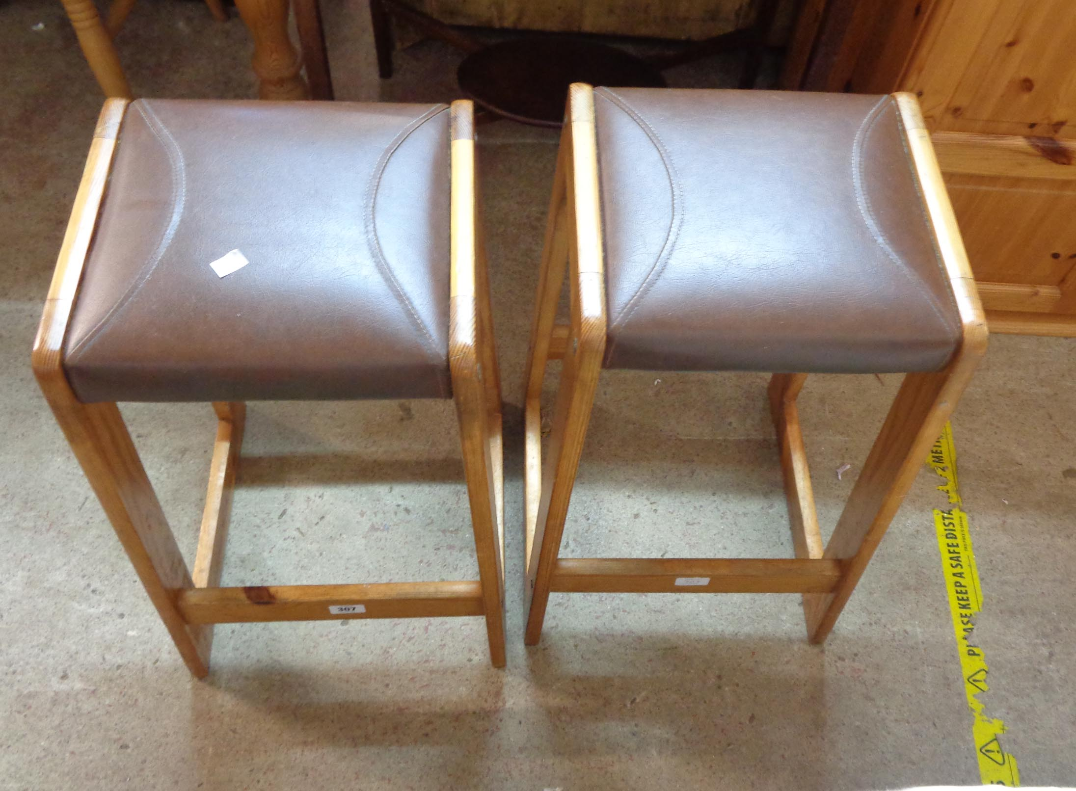 A pair of late 20th Century pine and leatherette bar stools