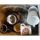 A box containing assorted china and glassware including Royal Commemorative mugs, glass dish and