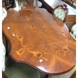 A 1.7m late 20th Century reproduction inlaid mahogany pedestal dining table with shaped top, set