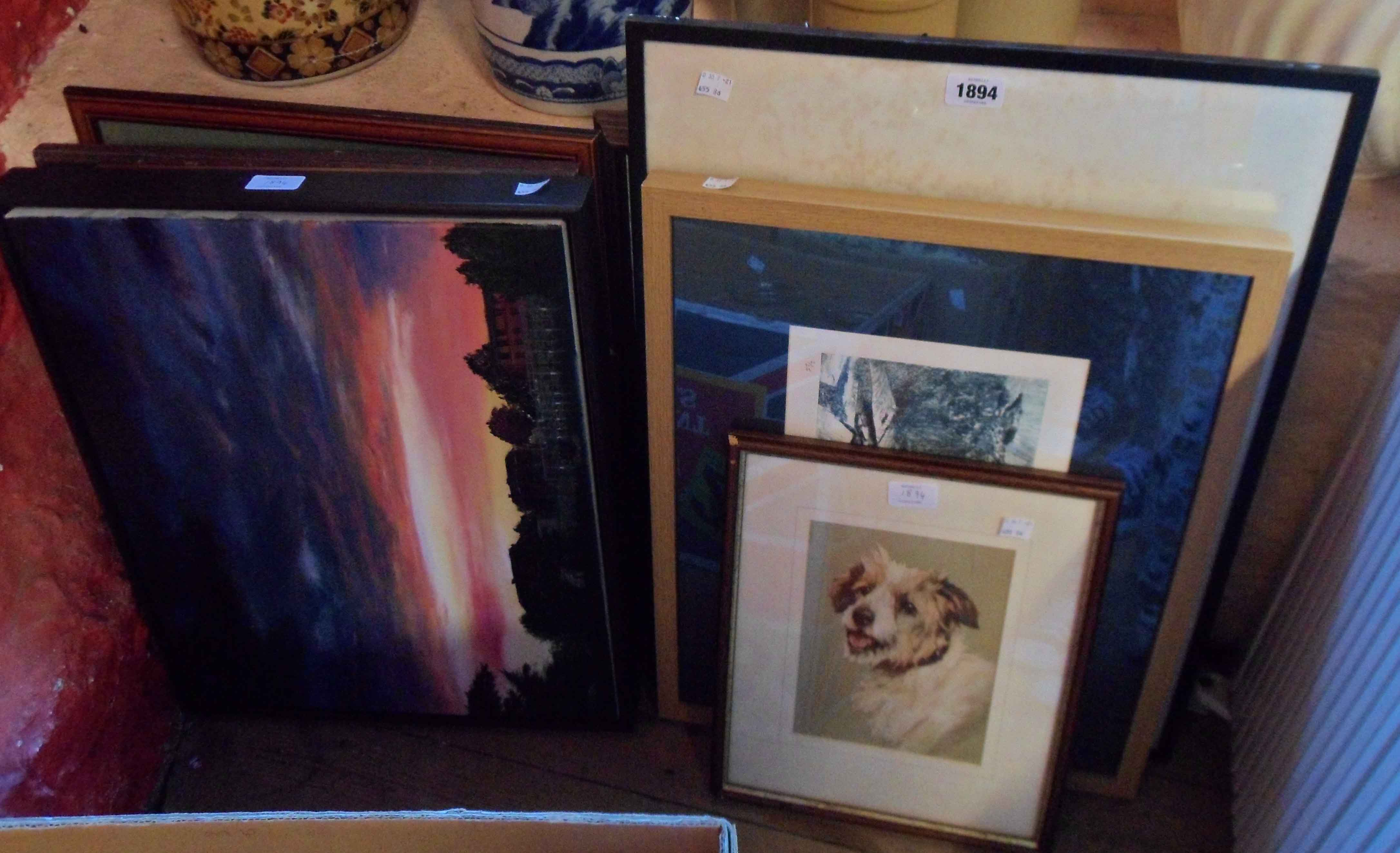 A collection of framed pictures including landscapes, animal studies, etc.