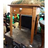A 59cm antique pine table with frieze drawer, set on square tapered legs - top warped