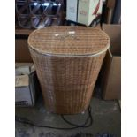 A woven linen basket with chrome fittings