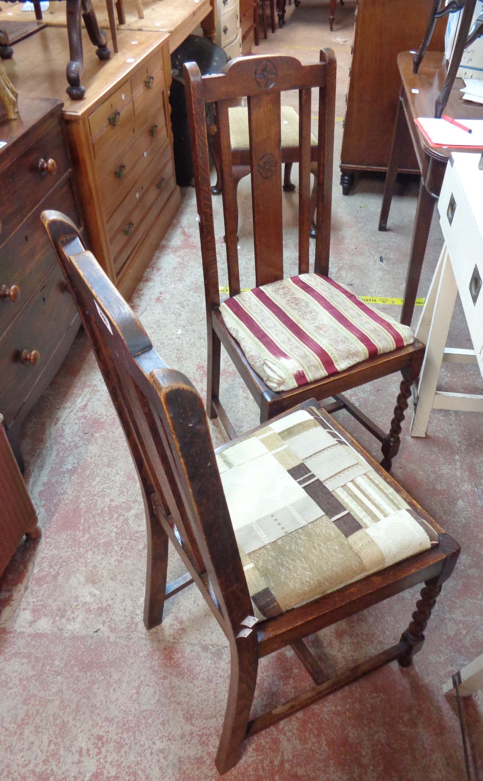 A pair of oak framed high lathe back dining chairs with drop-in seats