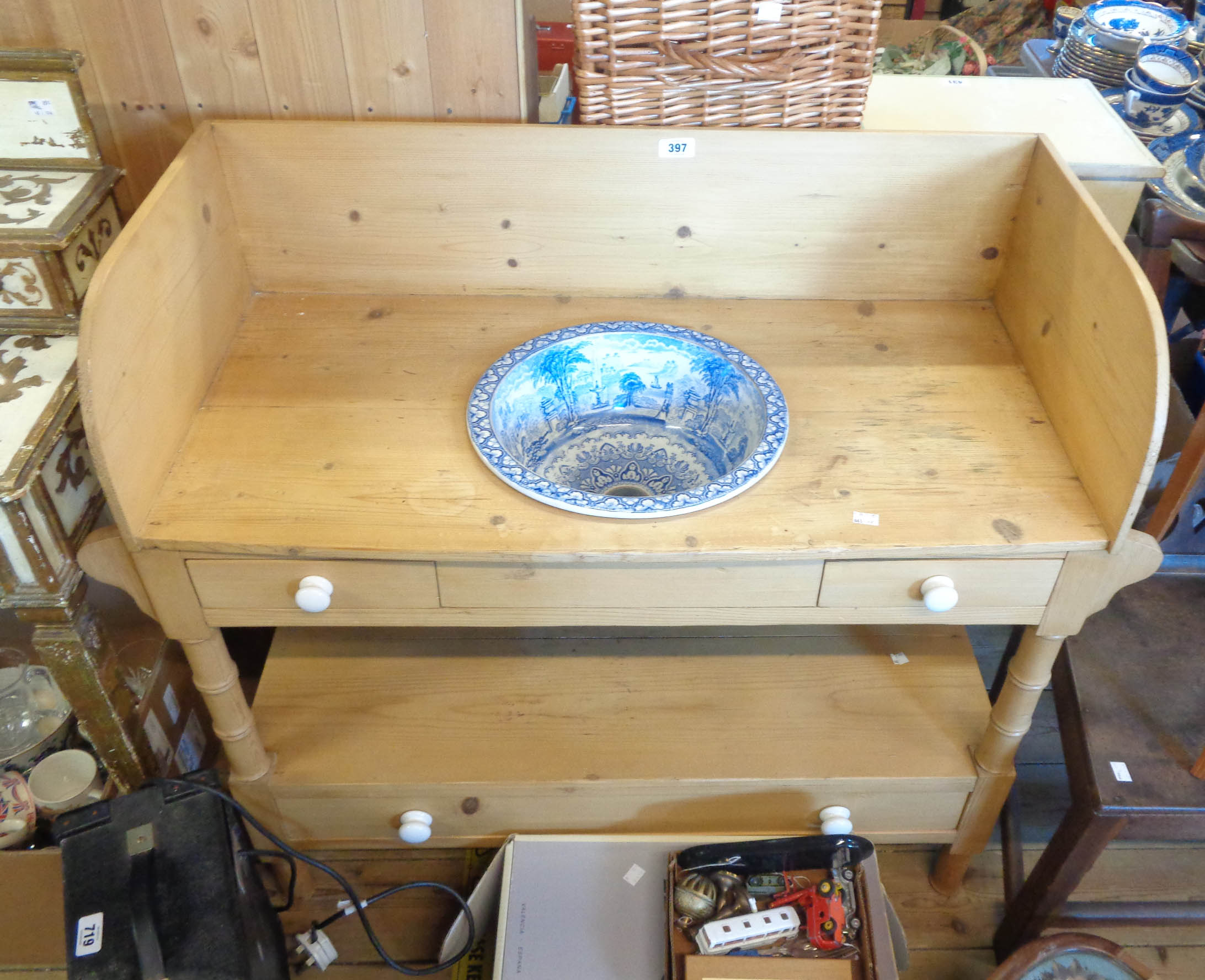 A 91cm Victorian stripped pine washstand with Panorama pattern blue and white china basin,