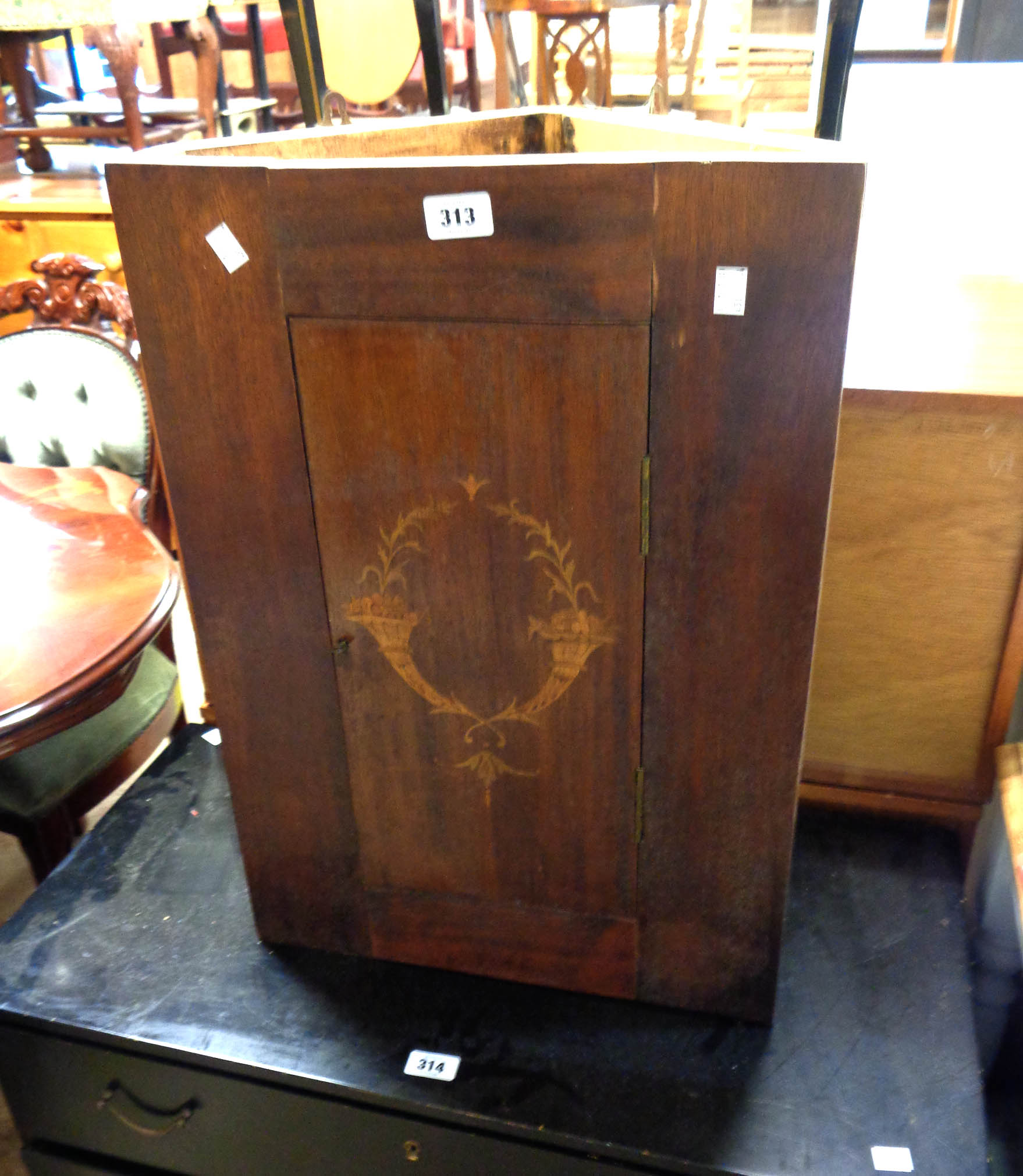 A 43cm antique inlaid mahogany wall hanging corner cabinet