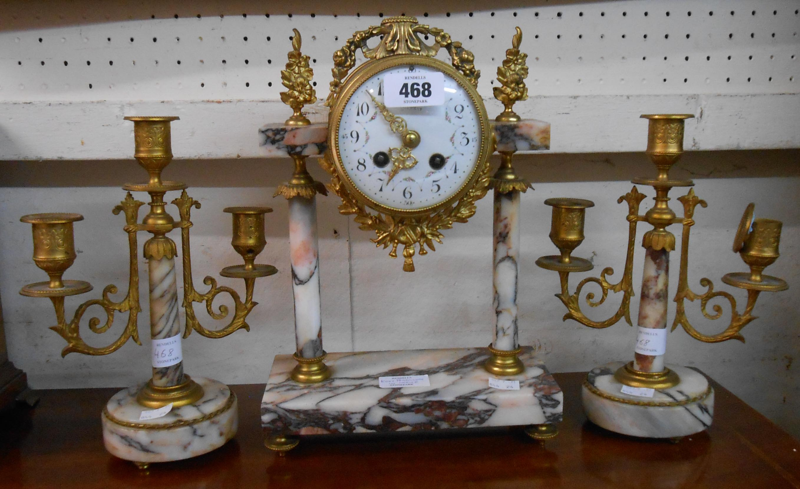 A 19th Century French clock garniture comprising ornate drum and marble pillar clock with eight