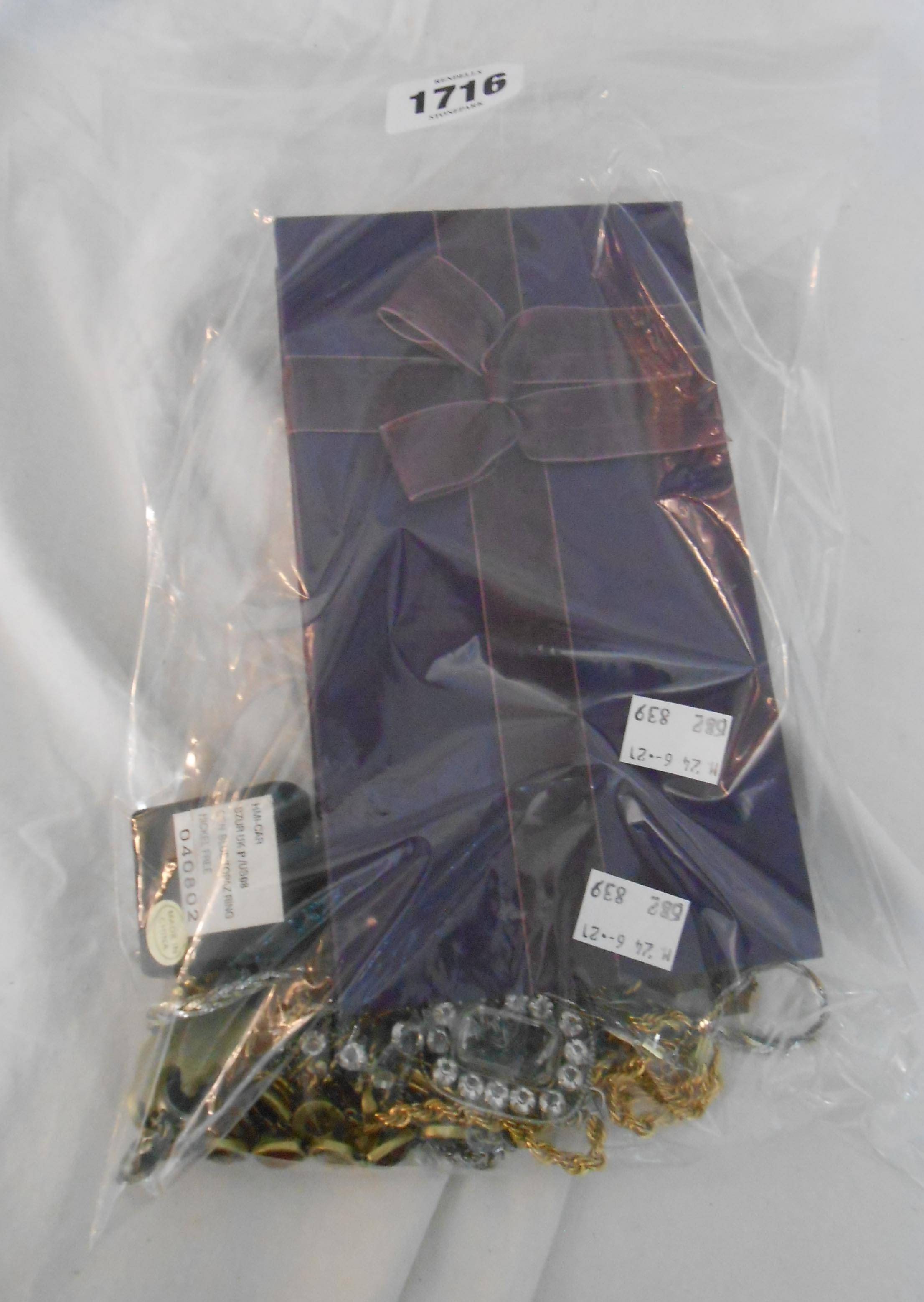 A bag containing a quantity of assorted costume jewellery