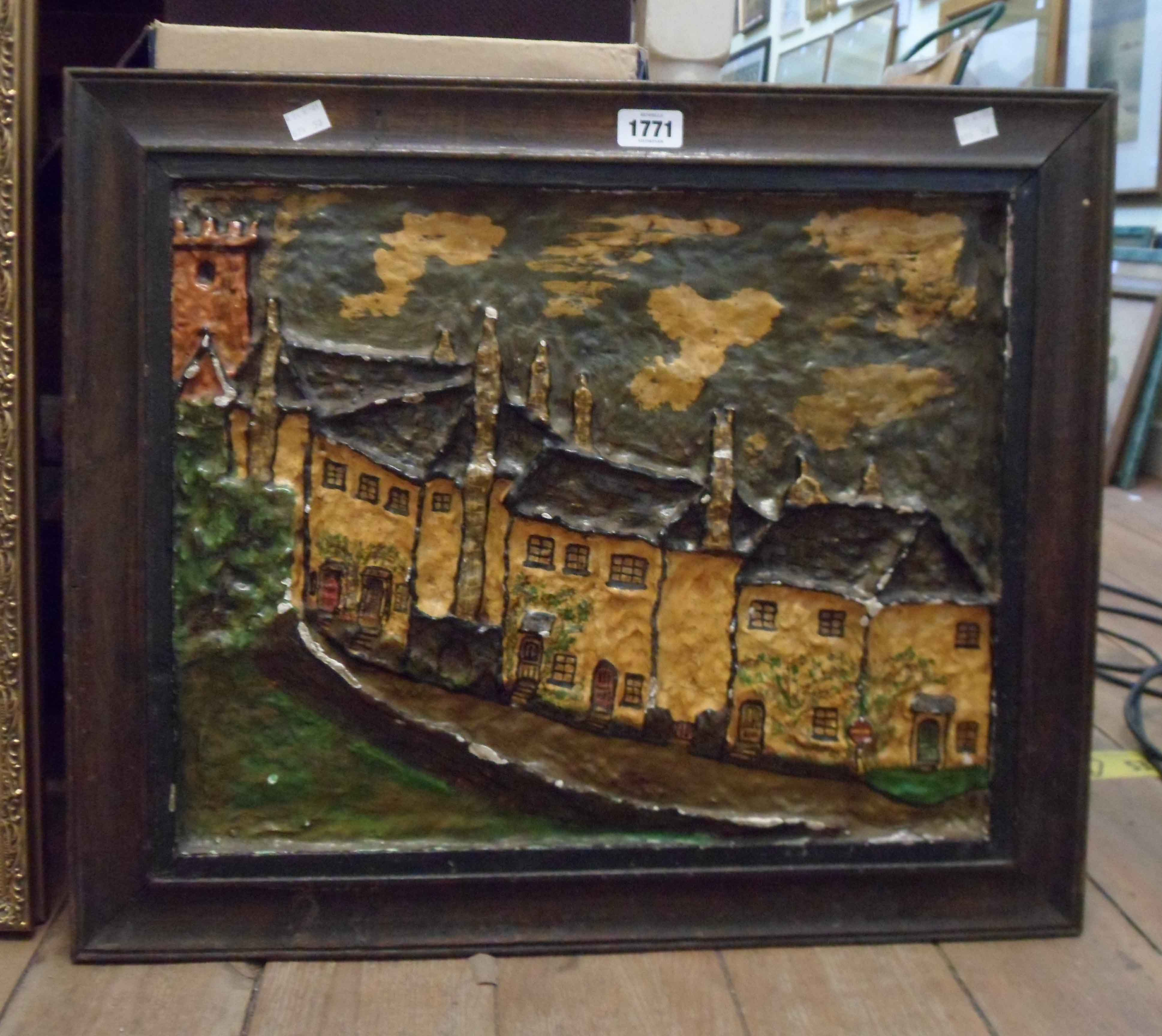 A vintage framed painted papier-mâché high relief picture, depicting a row of terraced cottages with