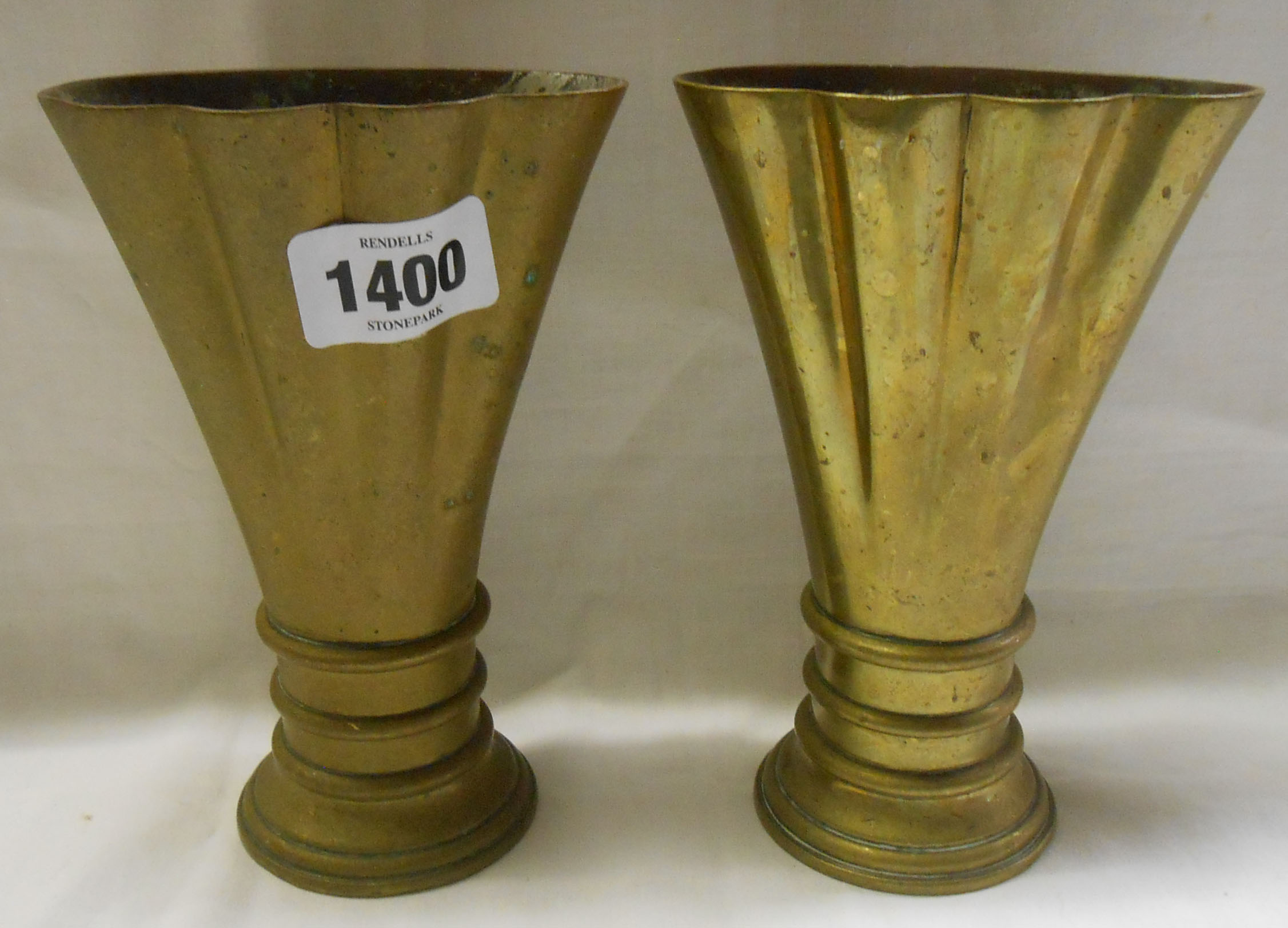A pair of Victorian J. Whippel & Co., Exeter, ecclesiastical brass vases - marked to the base