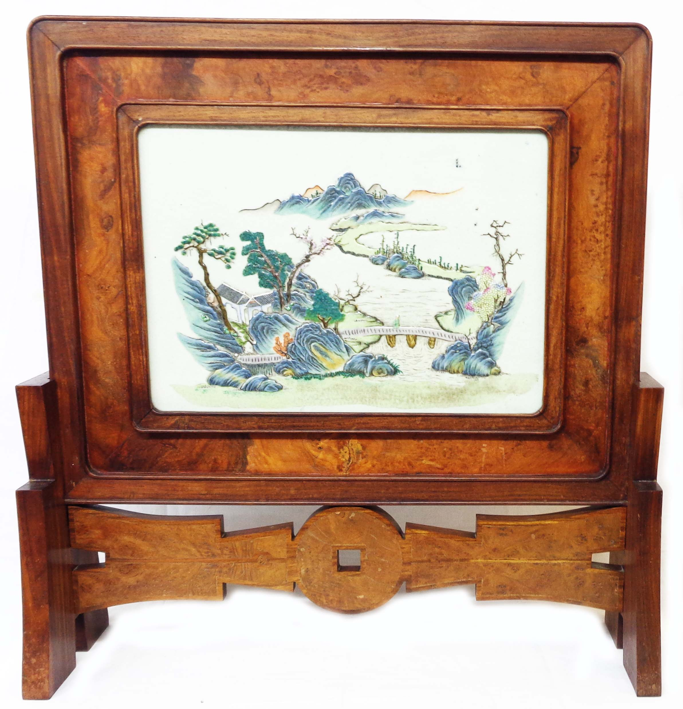 An early 20th Century Chinese table screen with central porcelain panel relief moulded with a