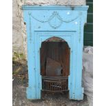 A Victorian cast iron bedroom fireplace insert, with blue painted finish