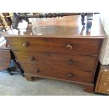 A 1.1m late Georgian mahogany chest of three long graduated drawers, set on bracket feet - splits