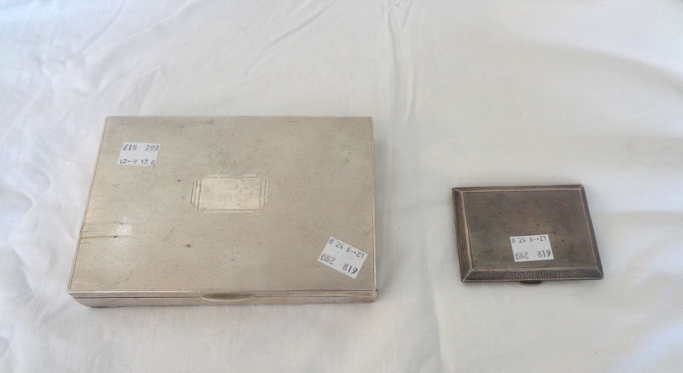 A silver clad cheroot box and a silver cigarette case - various condition