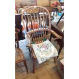An antique stripped elm Windsor hoop stick back elbow chair with solid moulded seat (named to back),