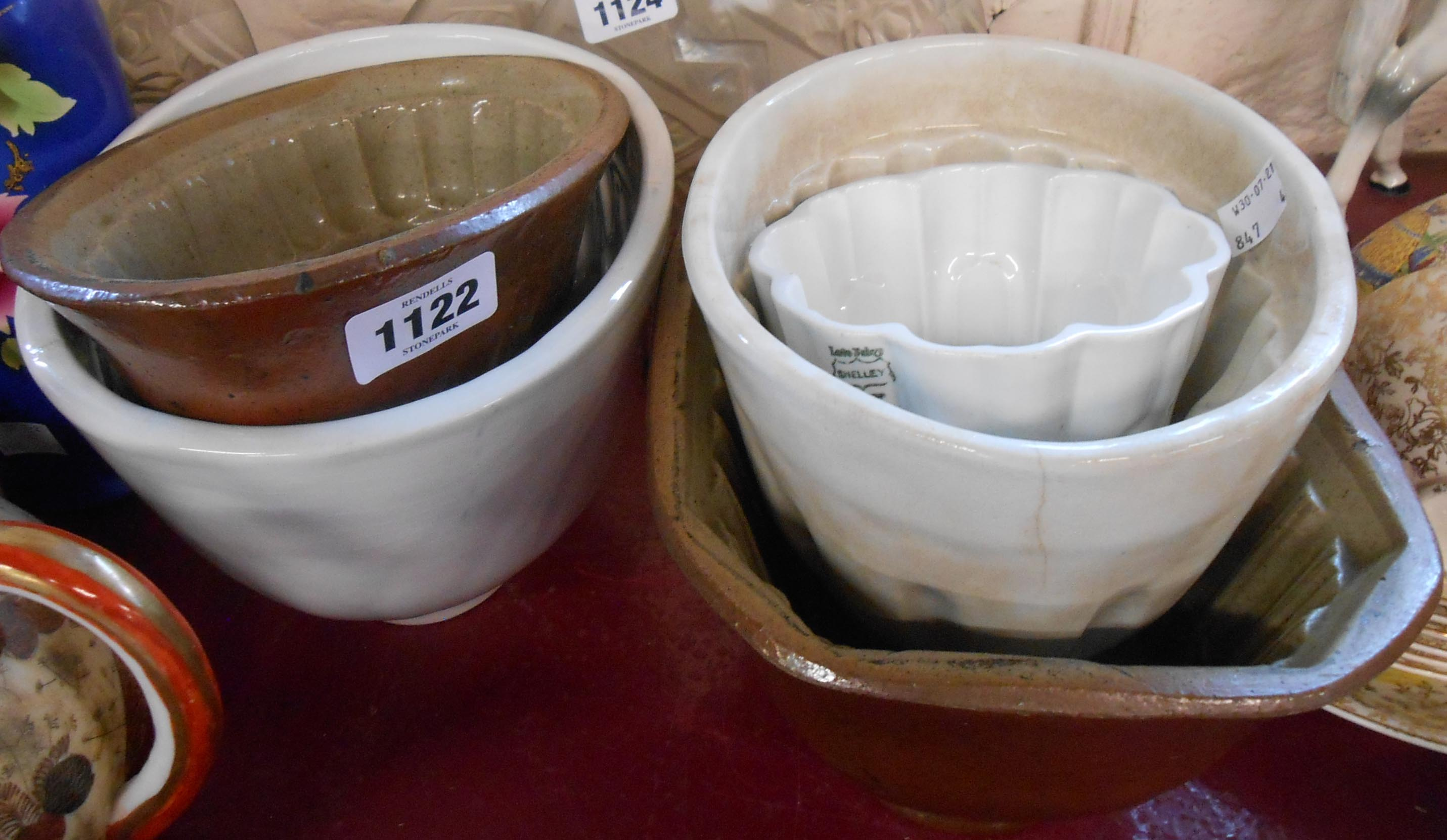 Five vintage jelly moulds including Shelley, salt glazed stoneware, and other examples