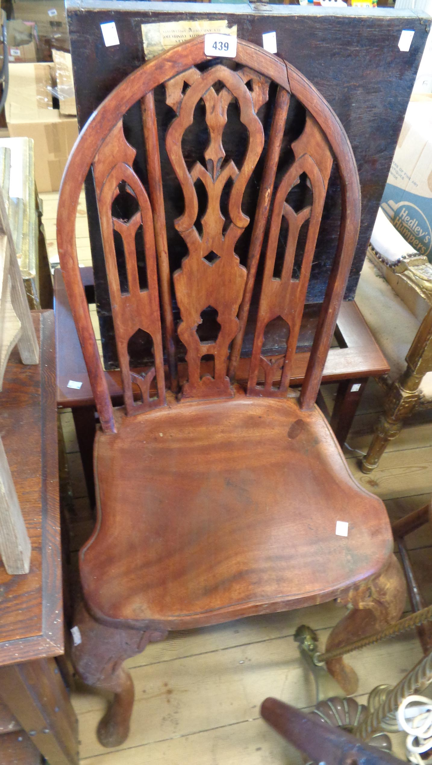 An antique stained wood mitre back standard chair with ornate pierced splat, solid moulded seat