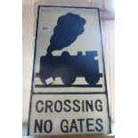 A modern reproduction painted cast iron Crossing No Gates sign