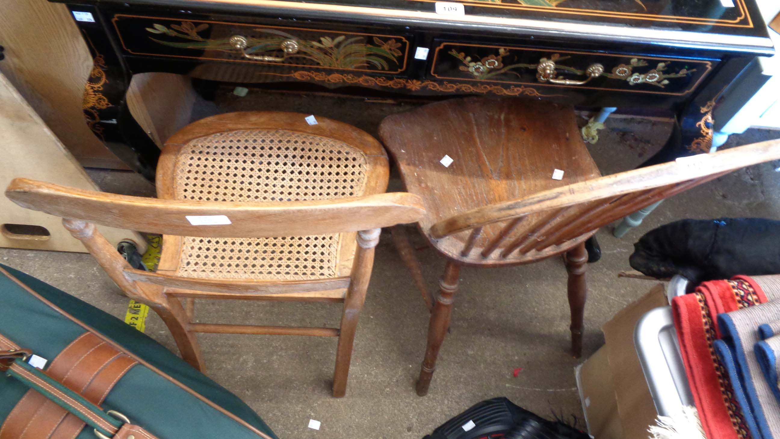 An old Windsor hoop stick back kitchen chair with solid elm seat, set on turned supports - sold with