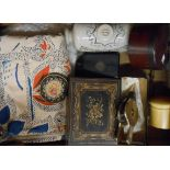 A box of collectable items including Doulton Lambeth foot warmer, novelty bellows lighter, shot