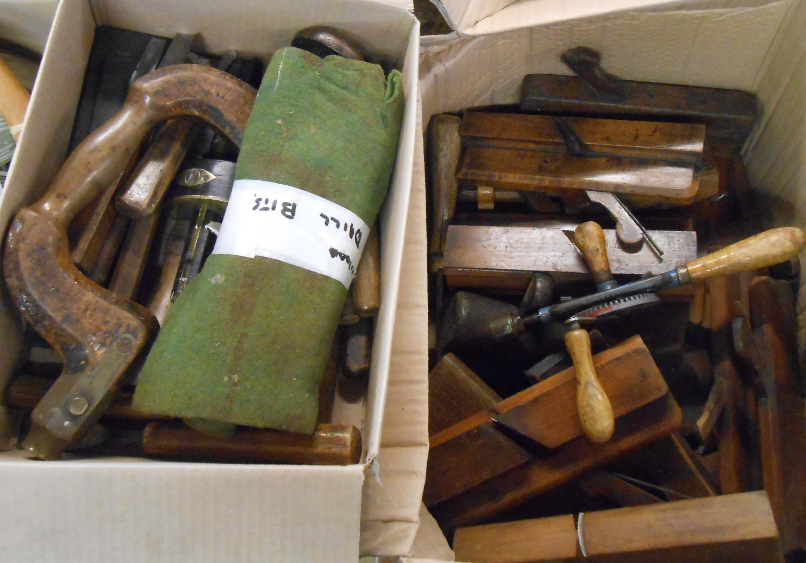 A collection of circa 1920's vintage tools including twenty five shaping planes, carpenter's brace