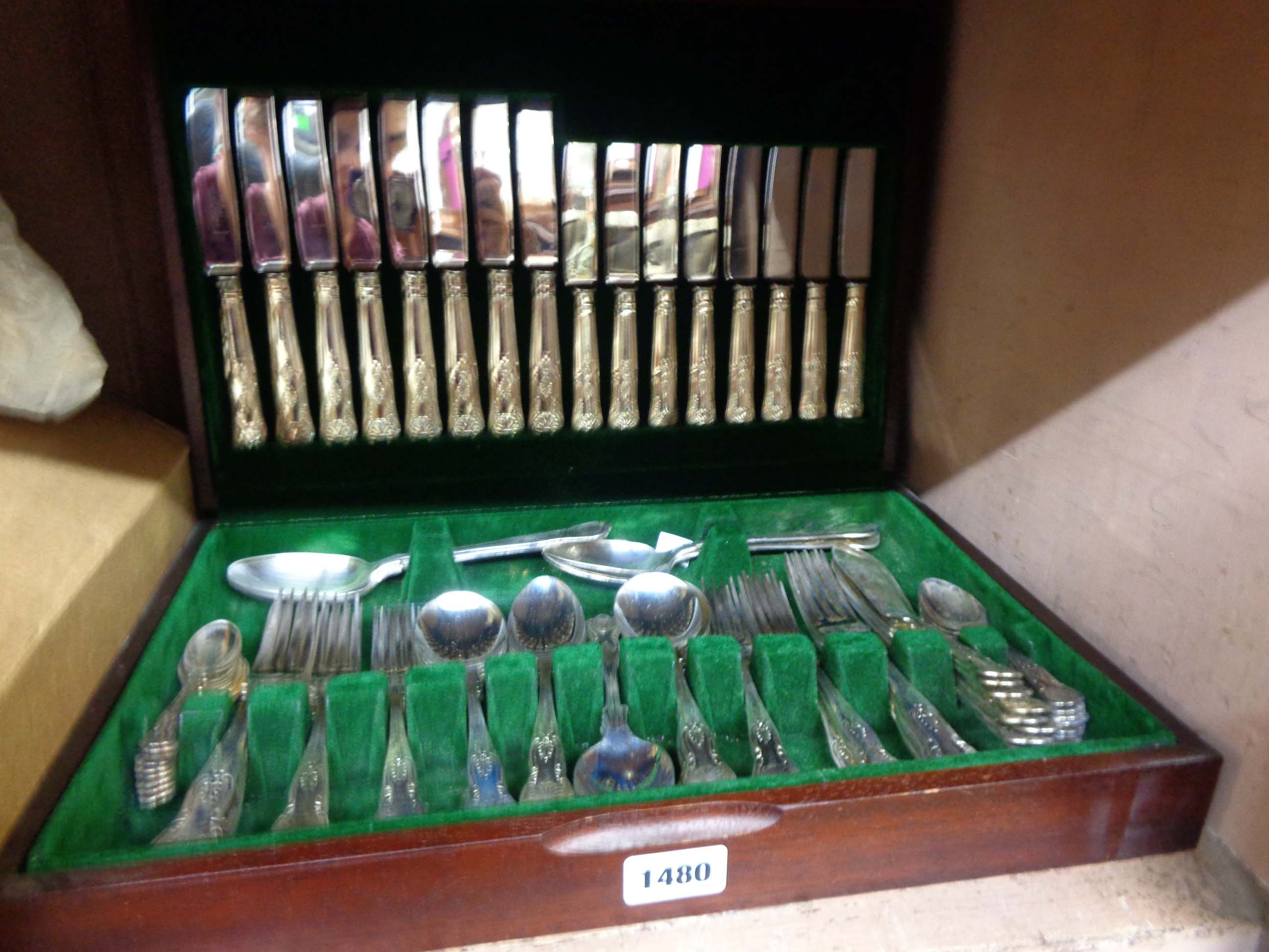 A polished wood canteen containing an eight place setting of silver plated kings pattern cutlery
