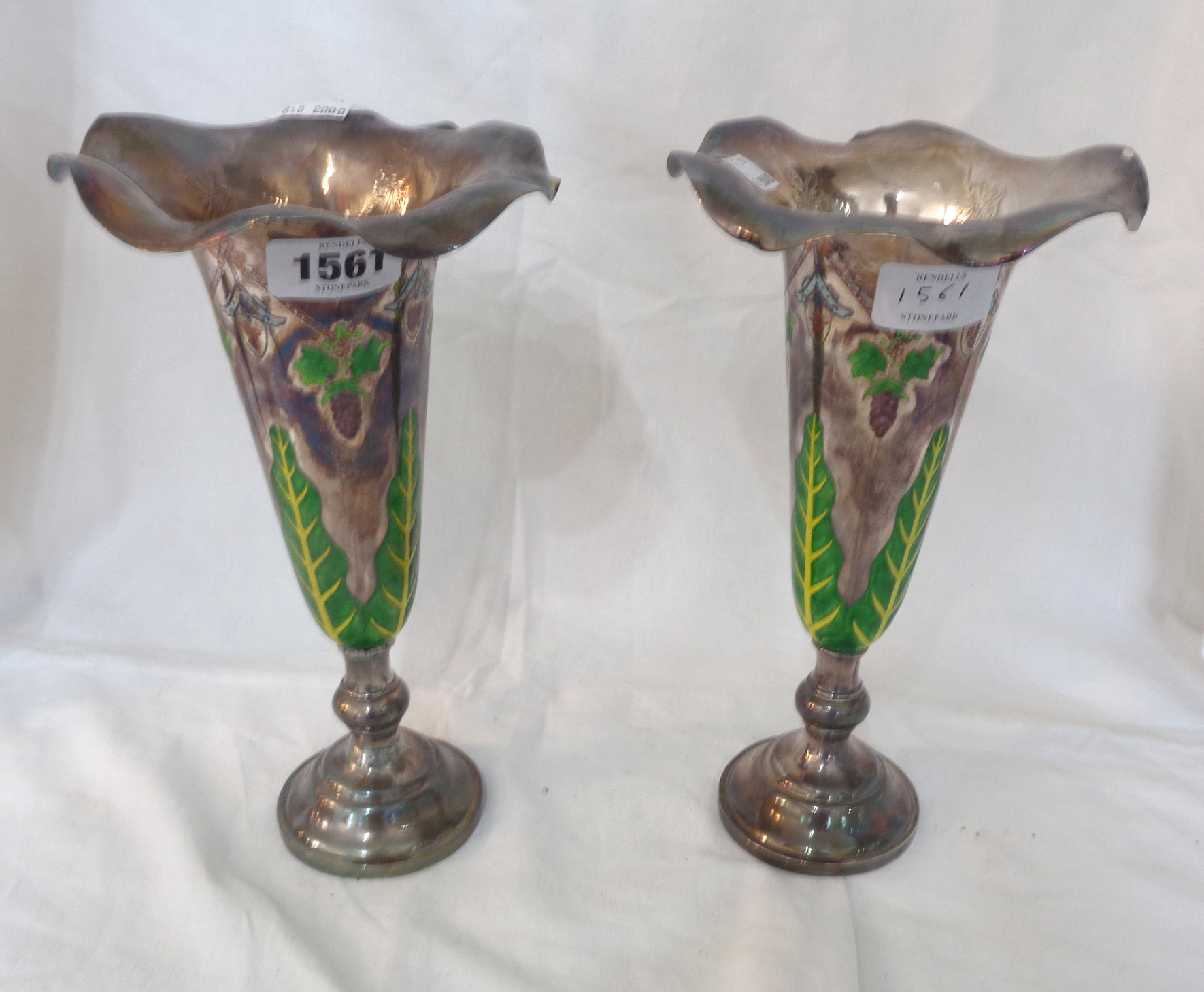 A pair of 25.5cm high Chinese white metal vases with enamelled foliage, grapes and motifs - rims