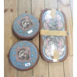 A pair of Victorian carved walnut framed circular footstools with remains of beadwork decoration,