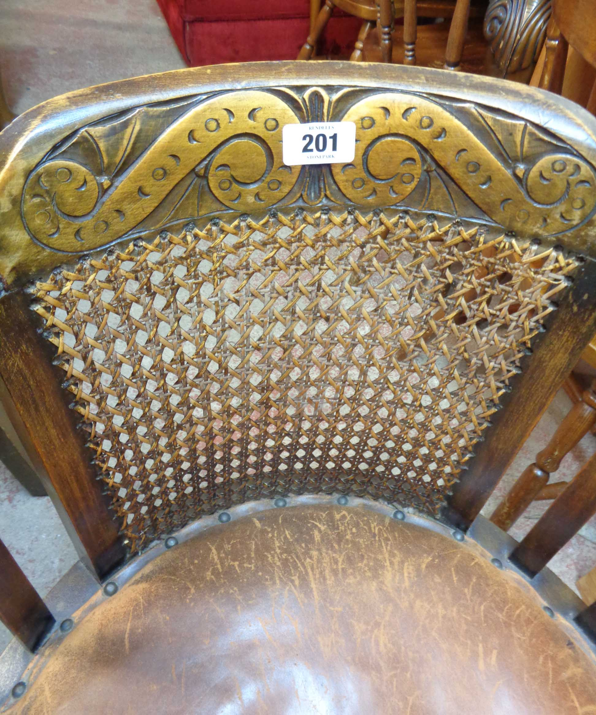 A 1920's oak framed tub elbow chair with remains of studded leather upholstery, set on bobbin turned - Image 3 of 4