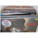 A bag containing assorted vinyl LPs including Ian Drury, Bruce Springsteen, U2, Blondie, Fleetwood