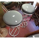 Two chrome plated framed bar stools with circular upholstered seats