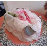 A vintage Christian Dior fashion hat with all over taffeta petals and fabric flower to top - some