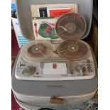 A vintage Grundig TK24 four track reel-to-reel tape recorder - sold with associated booklets,