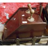 A wooden coal box with brass handle and associated shovel