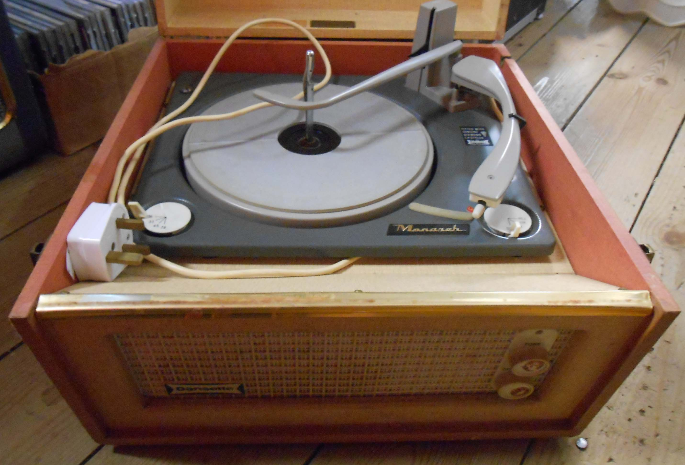 A vintage Dansette Bermuda portable record player with Monarch record deck