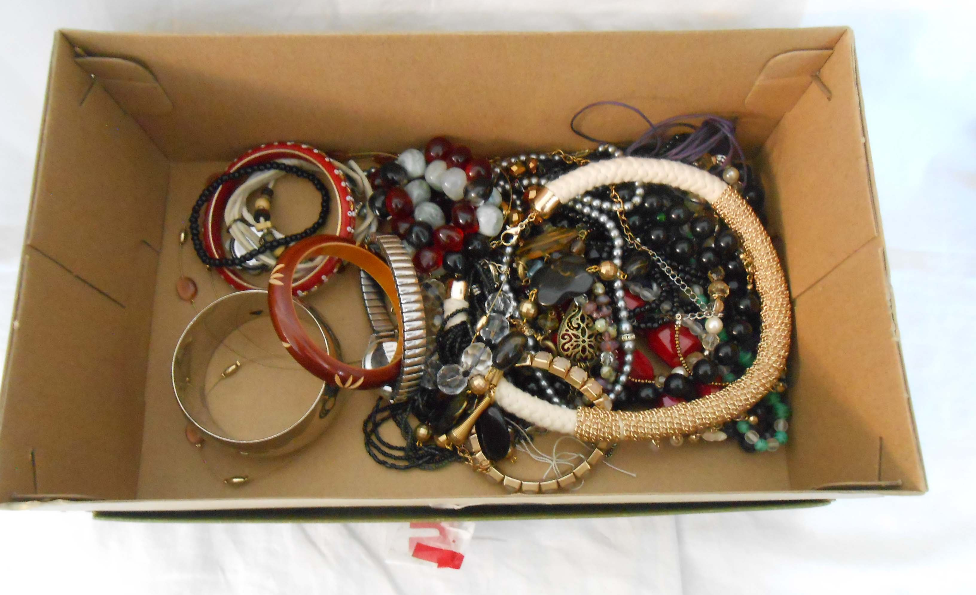 A box containing assorted costume jewellery