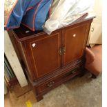 A reproduction mahogany TV cabinet