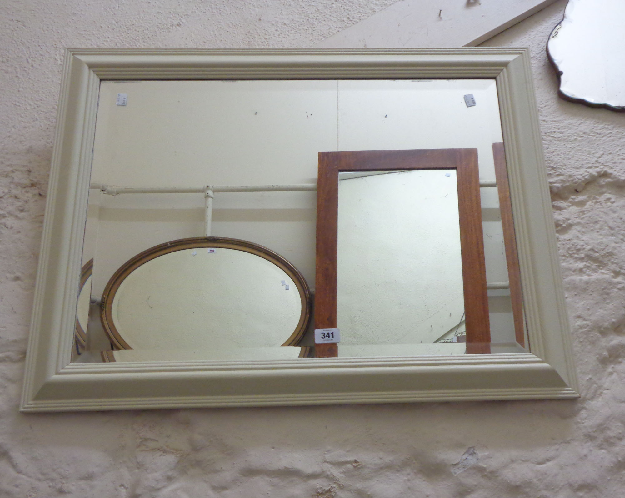 A painted pine framed bevelled oblong wall mirror