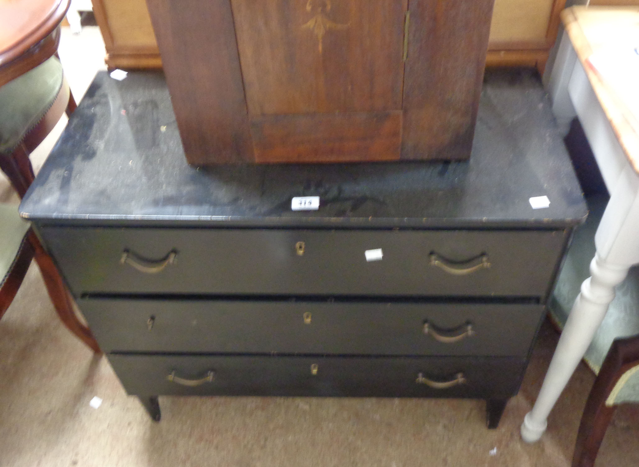 An 81cm retro stained wood chest of three long drawers, set on tapered legs - one handle missing