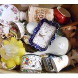 A box containing an assortment of ceramics