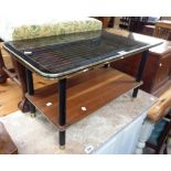 A 76cm mid 20th Century coffee table with geometric design to glass top, set on ebonised supports