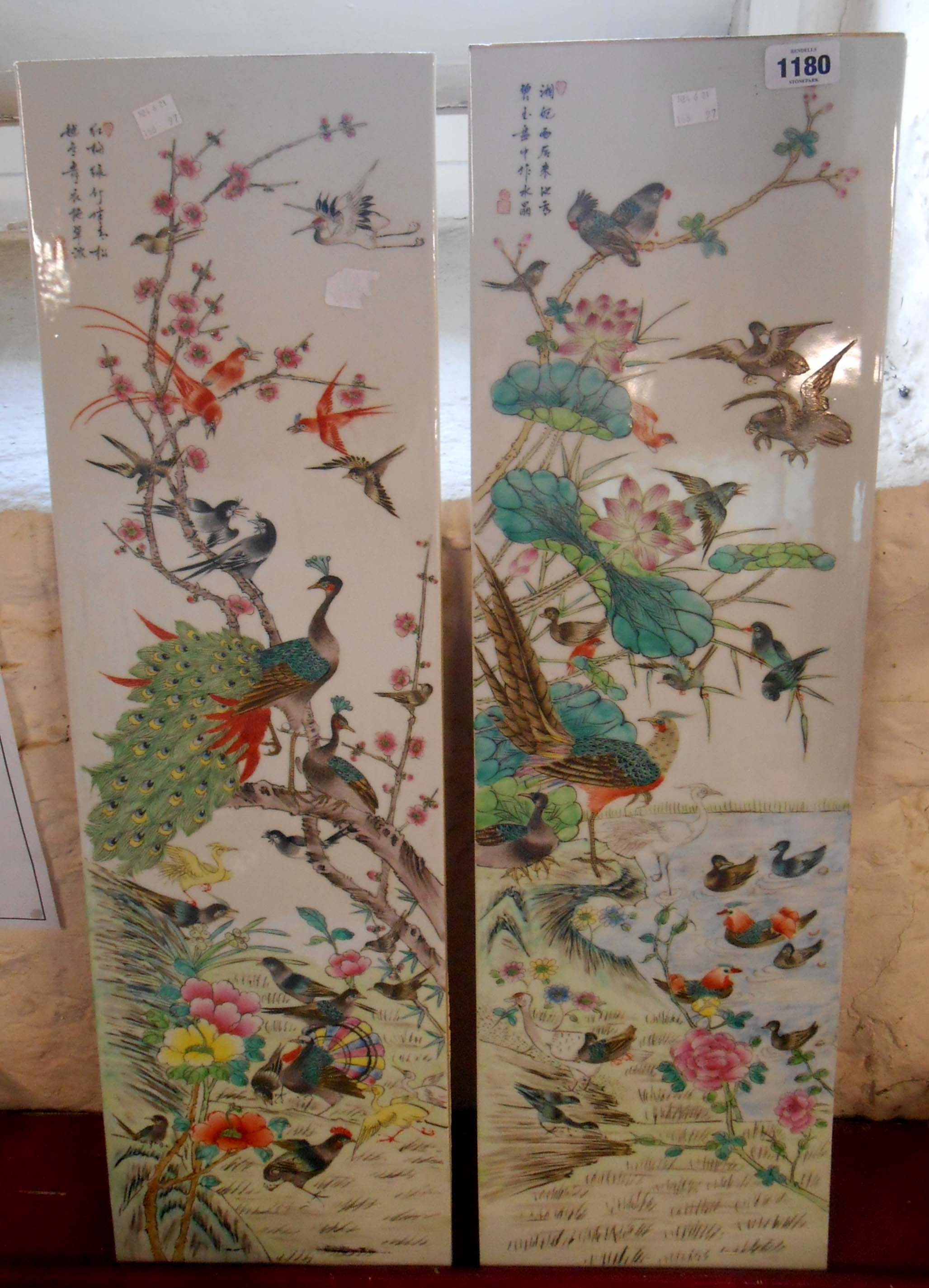 A pair of large 20th Century Chinese porcelain panels profusely decorated with various exotic