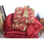 A 1.5m Harrods retailed knoll settee with red upholstery and decorative main cushions