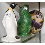 A Poole Pottery penguin figurine, a Dartmouth pottery gurgle jug and a Spring is in the Air