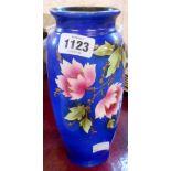 A vintage blue stencil decorated vase