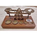 A set of Victorian Sampson, Mordan & Co., London, brass postal scales and weights