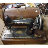 An old Singer sewing machine in wooden case