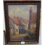 An antiqued gilt framed 1930's oil on board, depicting a village street - 39cm X 29cm